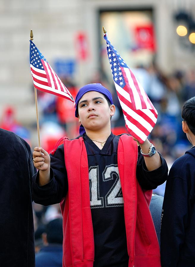 bigstock-Latino-boy-holding-American-fl-17337023